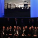 Guests and officials attend a ceremony on the site of the former Nazi German concentration and extermination camp Auschwitz-Birkenau near Oswiecim