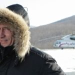 Clad in a heavy winter parka, Russian Prime Minister Vladimir Putin smiles upon his arrival in Kozmino to take part in a ceremony of commissioning the East Siberia - Pacific Ocean Oil Pipeline in Russia
