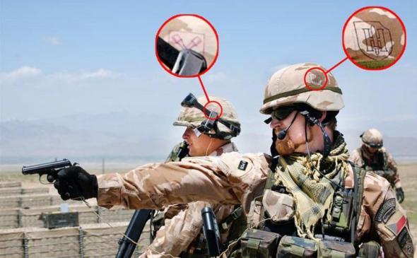 Знаки подразделений гитлеровской Германии Хоэнштауфен и Дирлевангер на шлемах солдат НАТО. Афганистан